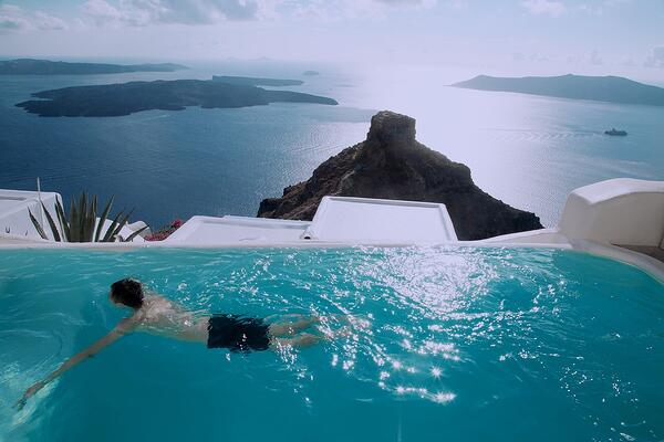views of Santorini cliffs from a pool