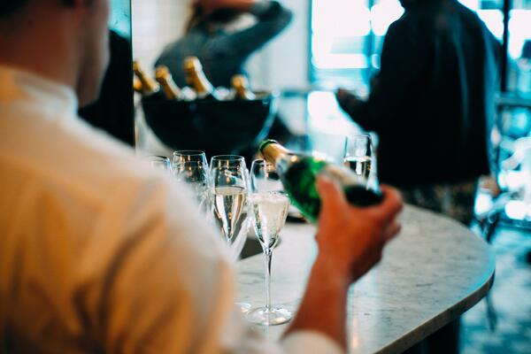 champagne being poured at a special occasion